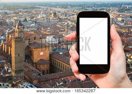 Tourist Photographs Bologna Skyline On Smartphone