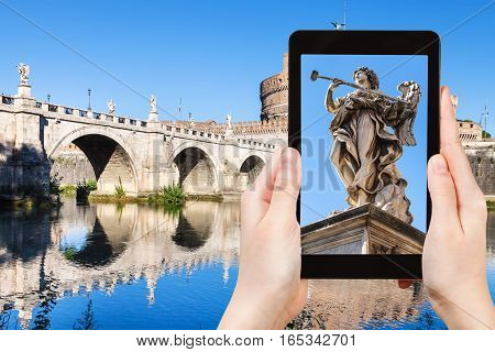 Tourist Photographs Angel Statue On Bridge In Rome