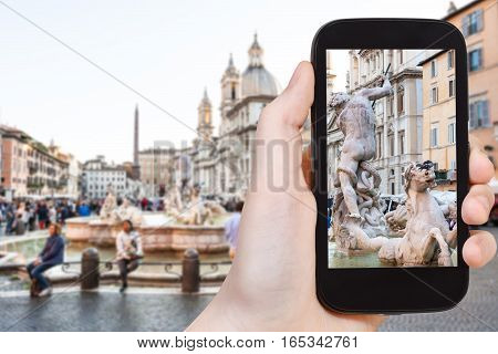 Tourist Photographs Sculptures Of Fountain In Rome