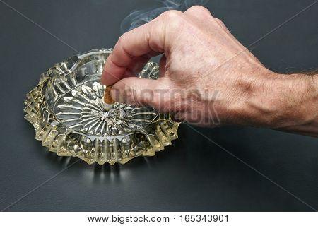 Man Give Up Smoking Cigarette And Crystal Ashtray