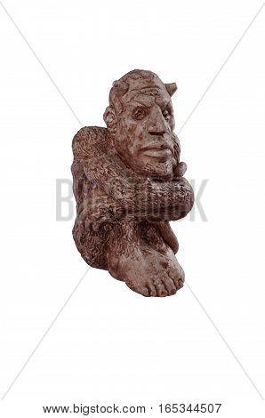 Clay handmade painted strange figure of sitting imp