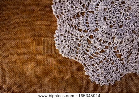 White lace tablecloth on a sackcloth texture