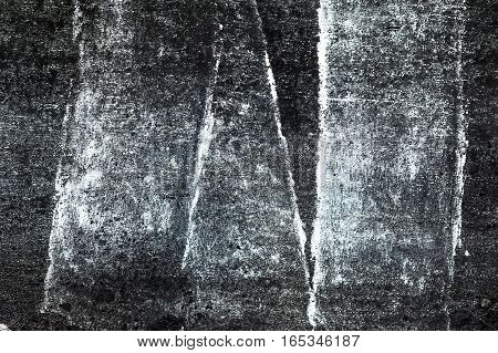 A black wall with white vertical stripes