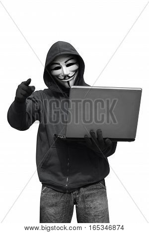 Hooded Hacker With Mask Holding Laptop While Appoint
