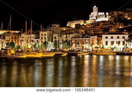 Boats moored up at the Ibiza waterfront at night
