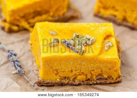 Slices of raw vegan pumpkin cheesecake. Love for a healthy raw desserts concept.