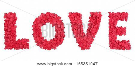 Red caption word love made of small hearts candy sprinkles over white