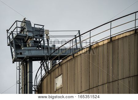 Industrial silos. Tall and with grey crane