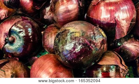 Group Of Purple Organic Onions In A Marketplace