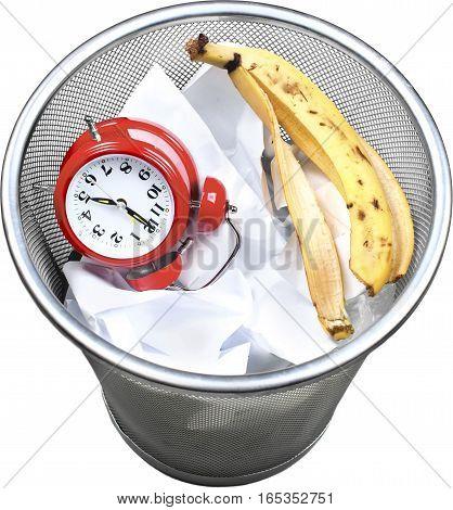 Alarm Clock, Banana Peel And Paper In Trash Bin - Isolated
