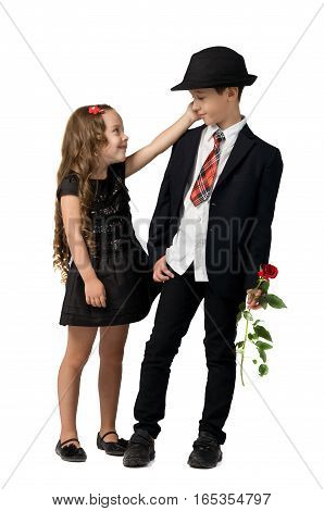 romantic relationship between young children. boy holding girl's hand