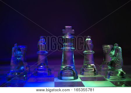 Glass chess on glass board on abstract background