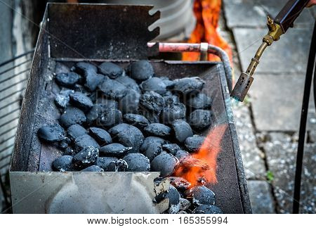 Firing Up Charcoal Briquettes For The Bbq Grill.