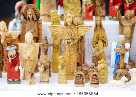 Carved Wooden Christ Statues Sold On Easter Market In Vilnius, Lithuania