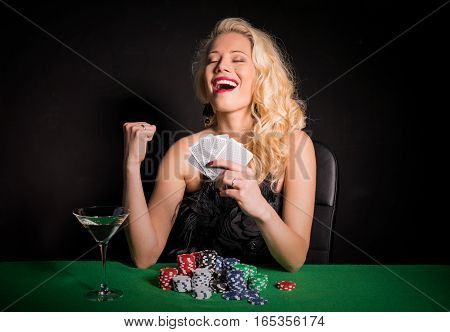 Woman wining a poker game celebrating her luck