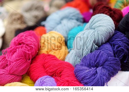 Many skeins of colorful wool felting sold on fair