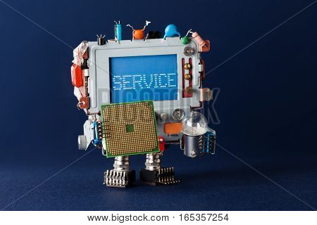 Service repairing concept. Toy tv robot handyman with cpu microchip and light bulb in hands. Warning message service on blue screen monitor head. macro view, blue background