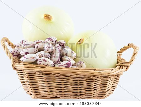 Onion and beans in basket on white background