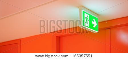 Bright green safety exit signal. Help to escape in an emergency.