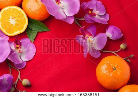 celebrate Chinese New Year background with beautiful blossom and slice fresh orange.