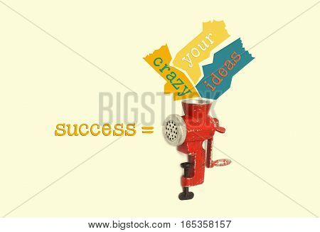 Winner concept. Retro meat grinder with colorful phrase Your crazy ideas success. Red mincing machine