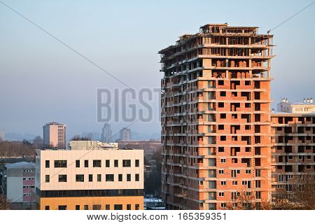 Unfinished building under construction and clear sky