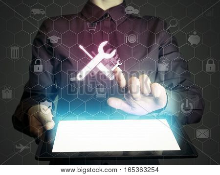 Image of a girl with tablet in her hands. She presses technical support button on virtual screen. The concept of customer support interface customization etc.