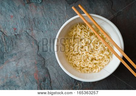 Soup Ramen noodles in ceramic bowl and bamboo sticks horizontal