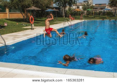 children in the summer camp train in the pool