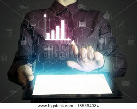 Image of a girl with a tablet in hands. She presenting a financial analysis using chart. Concept internet for business analytics.