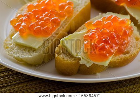 Red caviar on bread with butter close-up lots of sandwiches