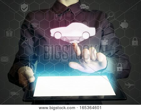 Image of a girl with tablet in her hands. She looking for a car for buying or for rent using online searching service.