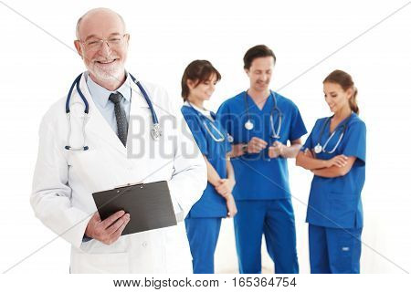 Smiling team of doctors and nurses on white background