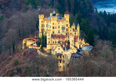 Hohenschwangau Castle Schloss aerial view with lake and bavarian alps, Fussen, Bavaria, Germany