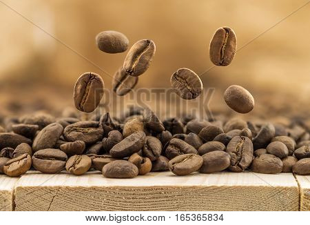 Flying fresh coffee beans as a background with copy space. Coffee beans falling down.