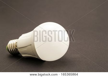 Glowing LED lamp on dark texture background
