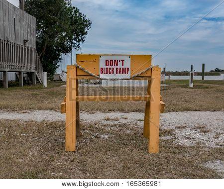 Don't Block Ramp Sign Along Marsh Waterway
