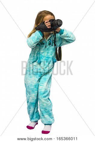 Young Girl taking photos with digital camera having fun and smiling girl in overalls home photographed