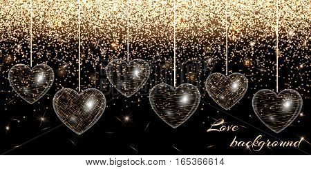 Valentine heart on a black background on a gold sparkling backdrop