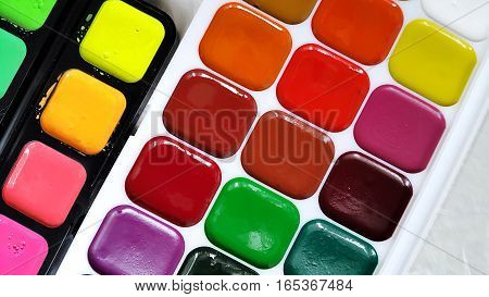 Close up of bright colorful watercolor paints