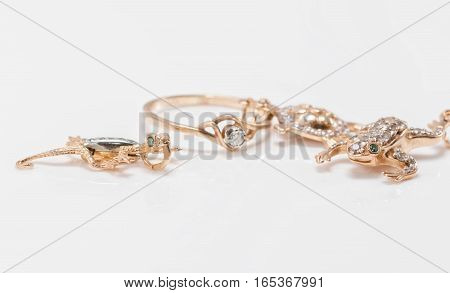 A Gold Pendant In The Form Of Turtles, Lizards And Frogs Are Along With Diamond Ring