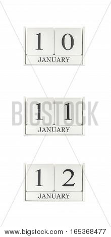 Closeup group of white wooden calendar with black 10 11 12 january word three date calendar isolated on white background