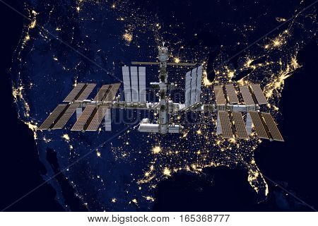 International Space Station over USA. Elements of this image furnished by NASA.