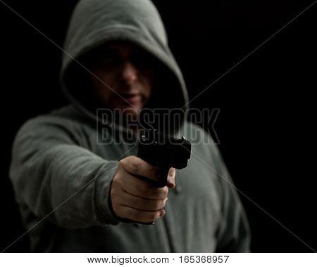 Thug In Hoodie Points Gun