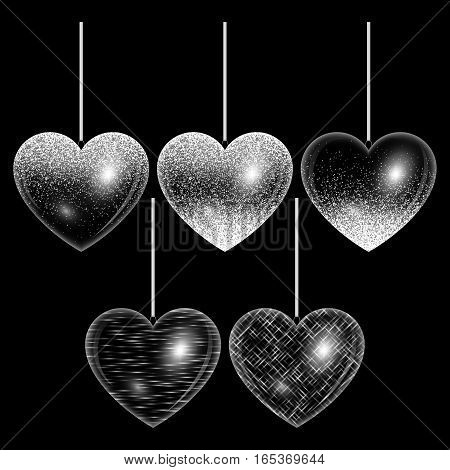 Set of hearts with light effects and silver highlights