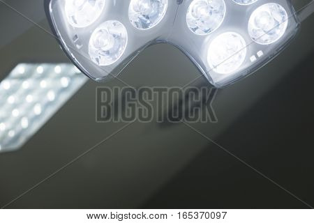 Operating emergency room surgery theater lighting in hospital to enable surgeon to see well in operations.