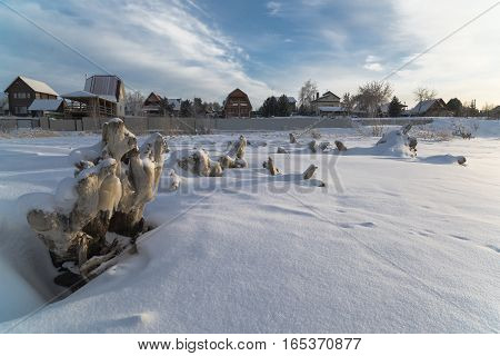 Siberia Novosibirsk region country houses on the banks of the frozen river Razdelnaya