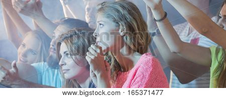 Young students attending the techno concert live
