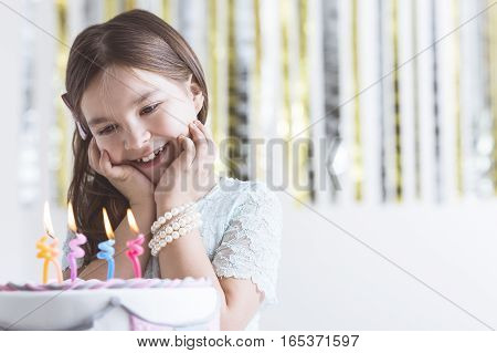 Girl Admiring Birthday Cake