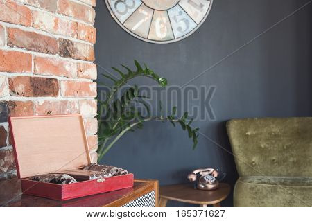 Stylish room corner with vintage telephone and coffret